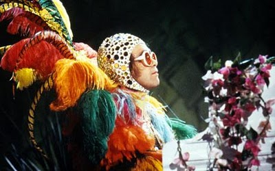 Elton John in Feather Outfit