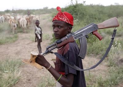 Turkana Boy with AK